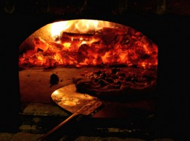 A mushroom and olive pizza in the wood oven