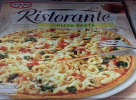 Box of frozen pizza with pasta topping