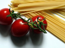 Some raw durum wheat spagetti an dsom ered cherry tomatoes