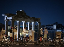Bikers in front of the Roman remains of Foro Imperiale in Rome