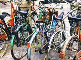 Colorful bikes parked in street in Bologna, Italy