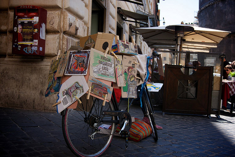 Bikes covered with tags and post it in Rome