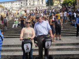 Two people standing on their segways in front of Piazza di Spagna in Rome