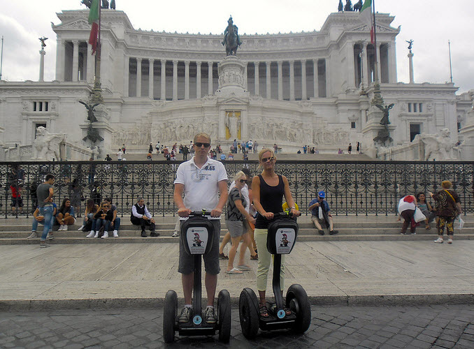People parking their Segways in front of Piazza venezia in Rome