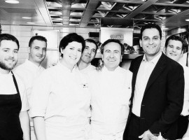 a b\w picture of a kitchen brigade with just a couple of ladies