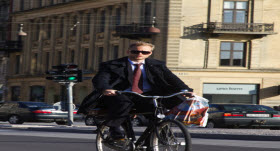 Young business man biking to work