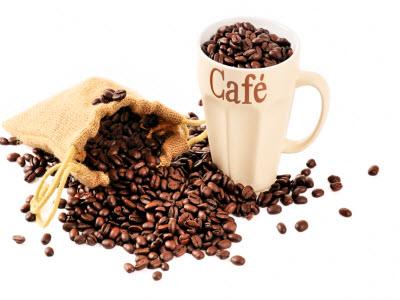 Coffe beans and a coffee mug