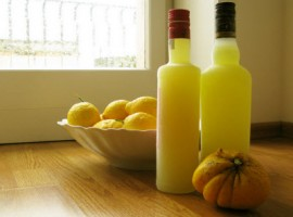 2 bottes of lemoncello and lemon fruits
