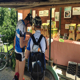 Cyclists pausing at a kiosk