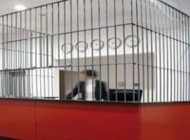 Reception in a cage at Alcatraz hotel
