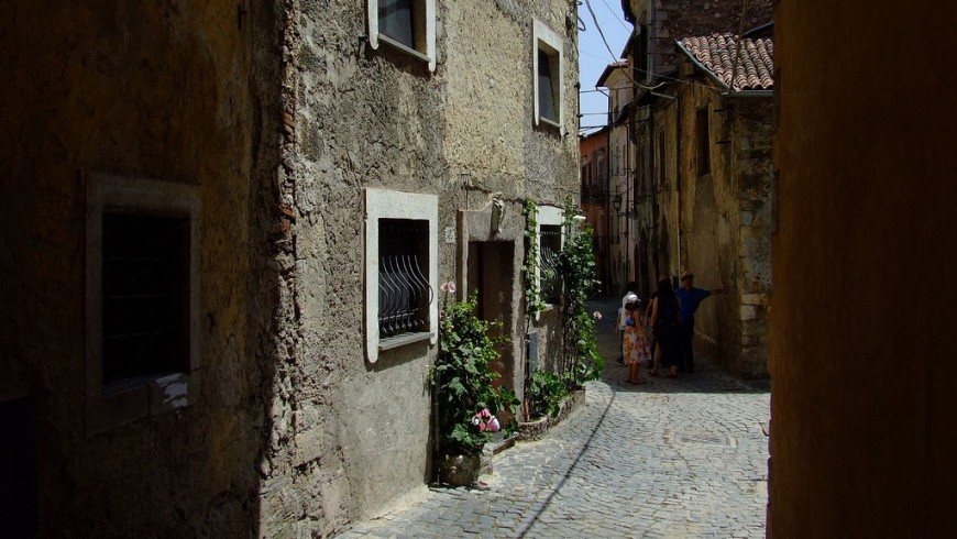 Along a street in the village of Tagliacozzo: old houses and some people