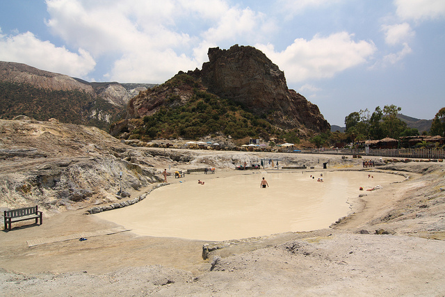 some people are sunk in the muds of the thermal pool (island of Vulcano, Eolie)