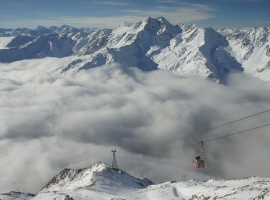 a chair lift in Val Senales, on the background a snowy mountain chain