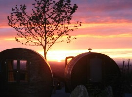 barrels used as rooms, the sunset on the background (Sesbachwalden)
