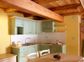 A chalet's kitchen of Ecovillage Sagna Rotonda, Piedmont