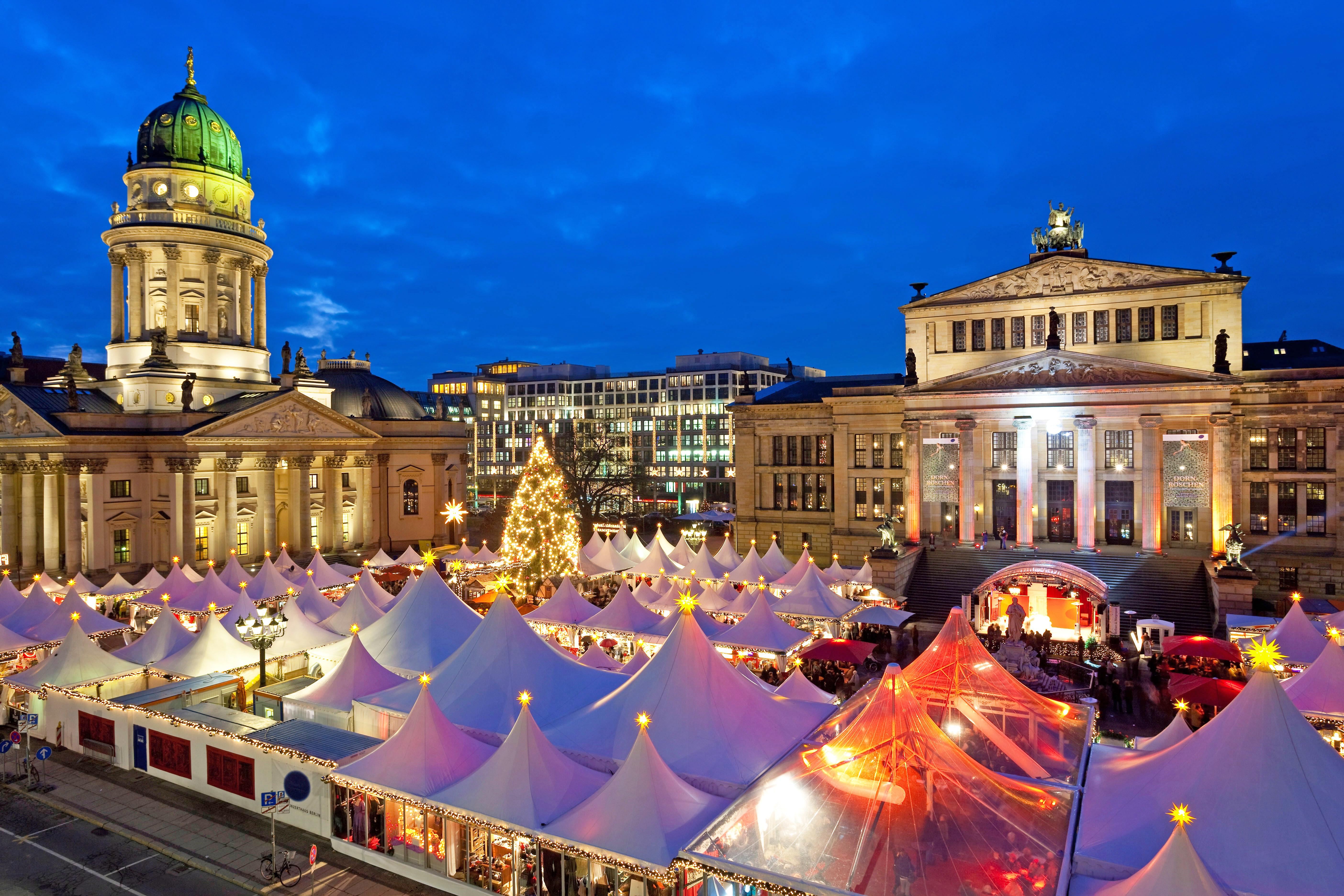 Traditional Christmas Market at Gendarmenmarkt, illuminated at dusk, Berlin, Germany, Europe