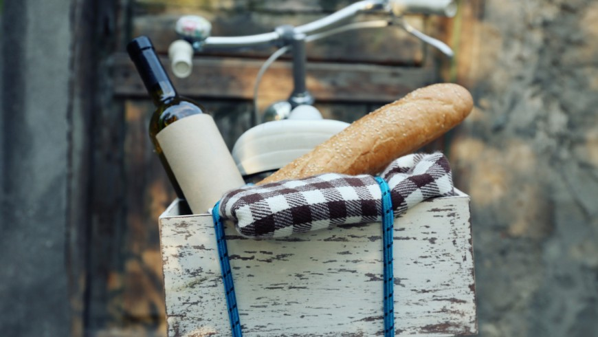 Eco-Picnic Bicycle with picnic snack in wooden box on old wooden door background