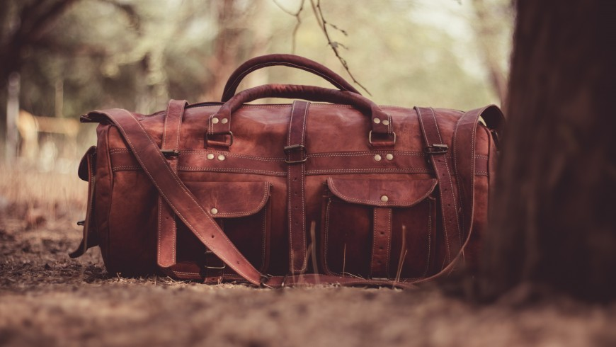 brown luggage - the first tip to travel in an eco-friendly way is to reduce your luggage