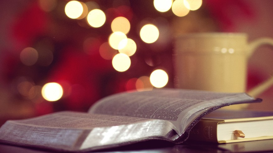 Open book with Christmas' lights, green Christmas, photo by Aaron Burden via Unsplash