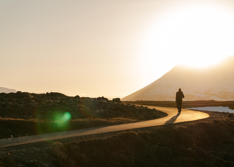 Man walking on a path, photo by Mahkeo via Unsplash