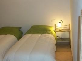 Bedroom in Ca' del Campanaro, bio agritourism in Villa D'Aiano, Castel D'Aiano