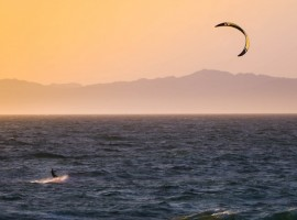 Kitesurfing, photo by Tim Martin via Unsplash