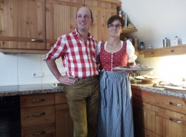 "A family inviting us in their farm during the ""Aufwart'n am Weissensee"" festival"