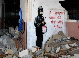 """I remember when all this was trees"" by Banksy. Photo via Focus"