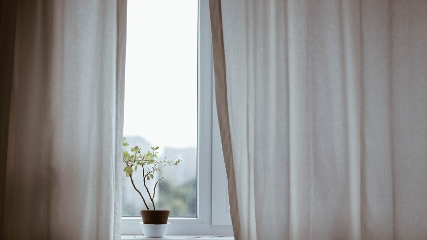 Manage Heat and Light to Keep Your Bedroom Cool Without the Air Conditioning