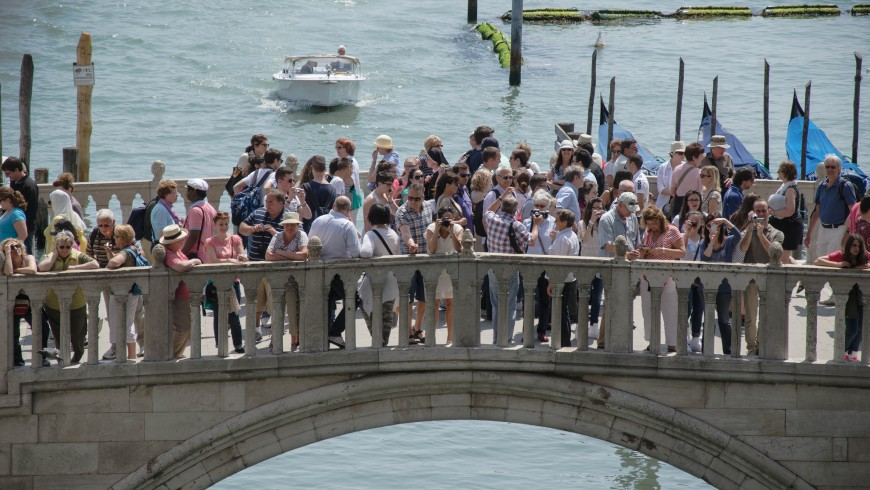 Tourists crowd into Venice's bridges