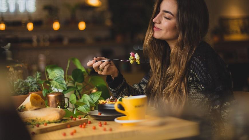 Girl eating in a vegetarian restaurant