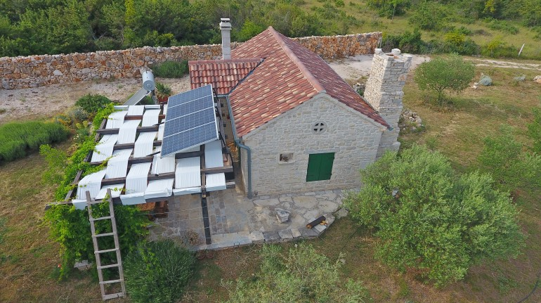 Aerial view on the house, with the solar panels on the roof