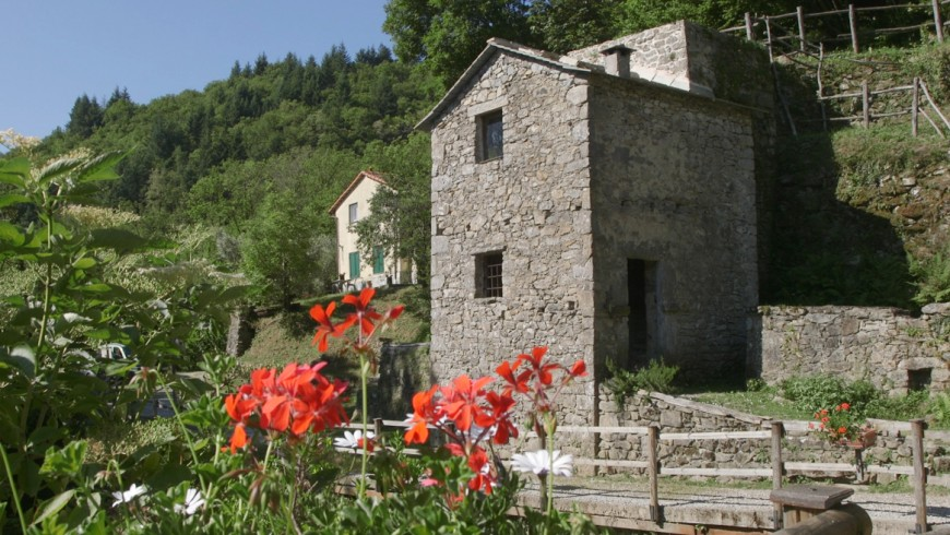 """The unique structure of the Belpiano mill, with the """"tower"""", seen from outside. Aveto Park, Liguria, Italy"""