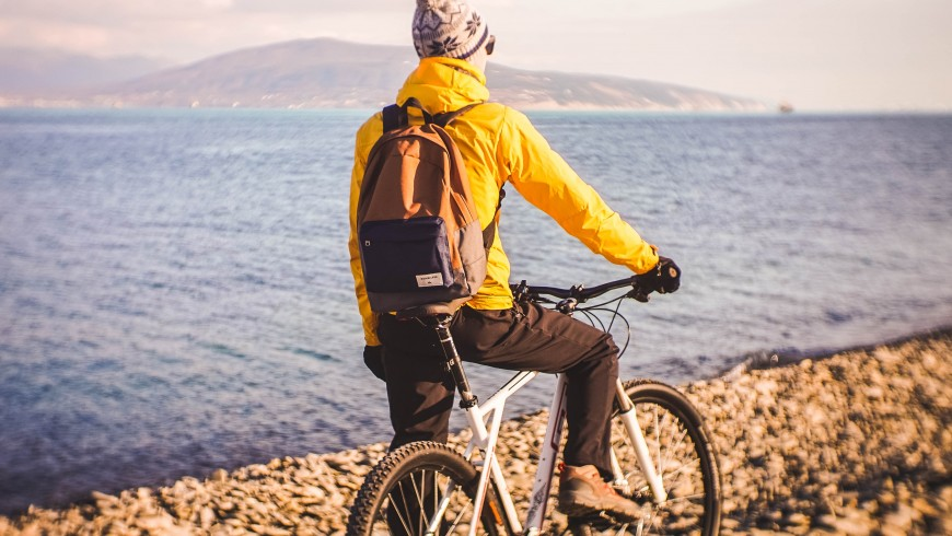 Man on his bike, staring at the sea