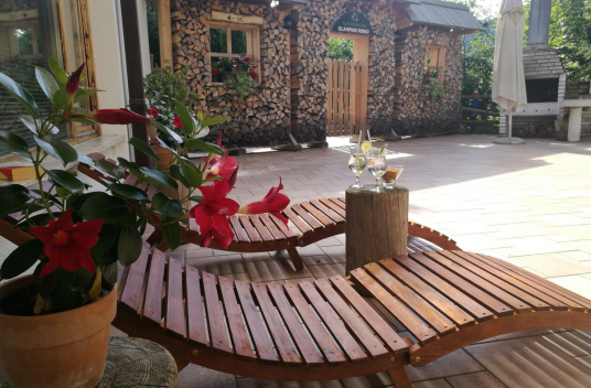 outdoor relax area at hotel and glamping Ribno