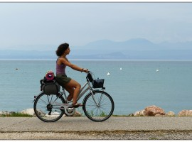 lady with bycycle by the sea slow tourism