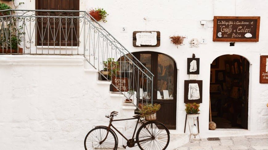 bike parked near a white charming house