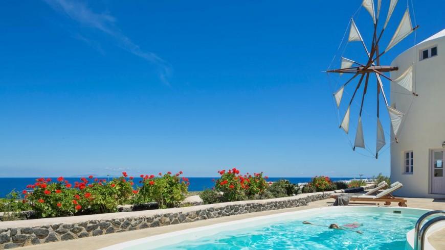 Windmill-shaped villas in Greece