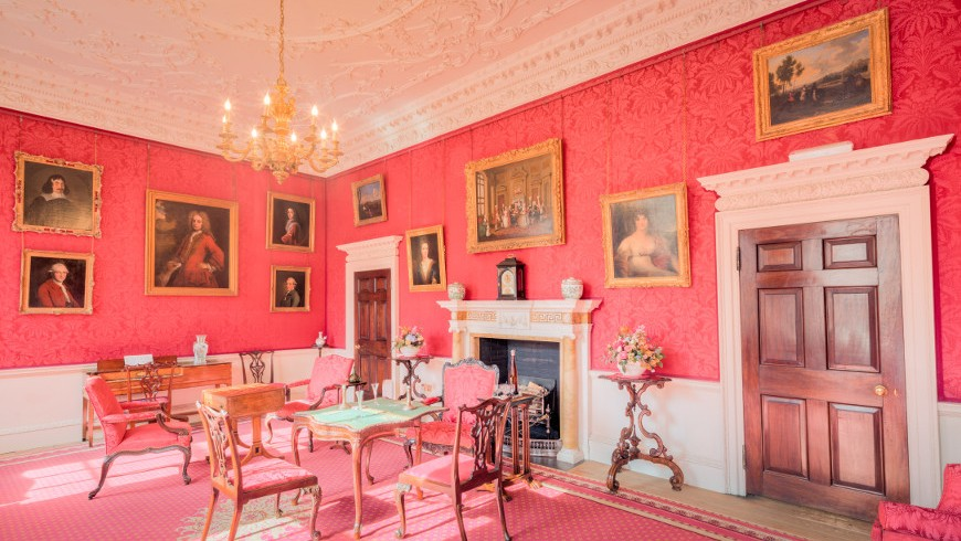 Interioir design of the Fairfax House, with tables, chairs, cheminy, paints and pink walls