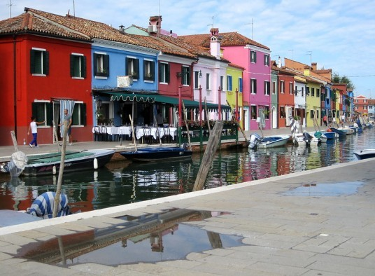 colourful houses of Burano and a small canal under them