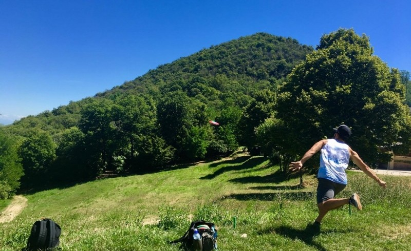 Boy playing Disc Golf in the Euganean Hills, near Padova