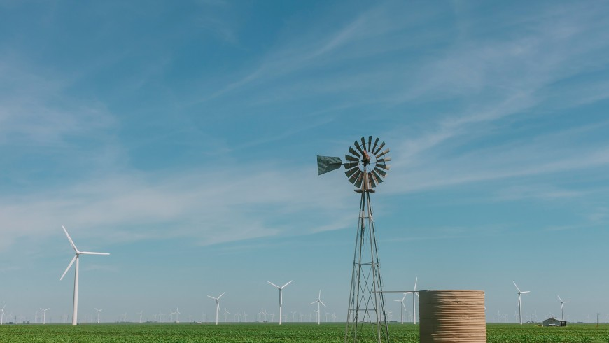 A windmill and wind turbines in West Texas.