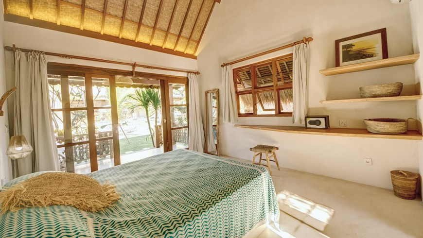 Room with natural furniture at Mule Malu Tropical Stay