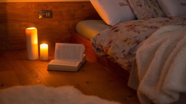 Photo: cozy evening reading. Source: eco chalet Astra Montana