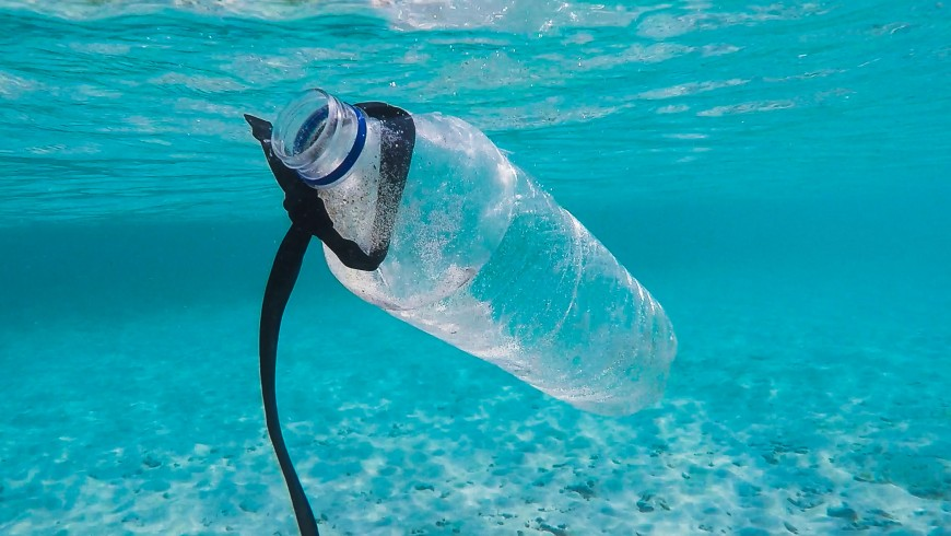 Plastic bottle in the ocean, Gili Islands, Indonesia.
