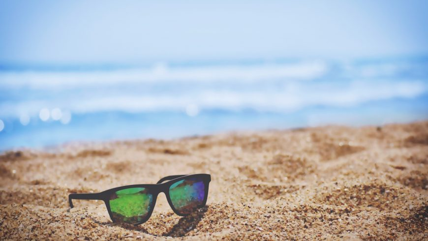 sunglasses lying on the beach