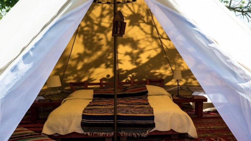 interiors bed in glamping tent