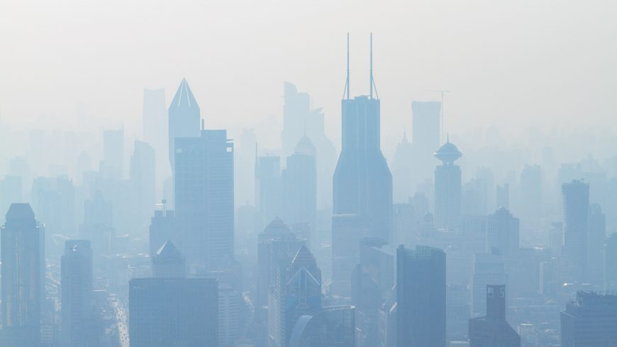 aerial view of smoke-covered skyscrapers