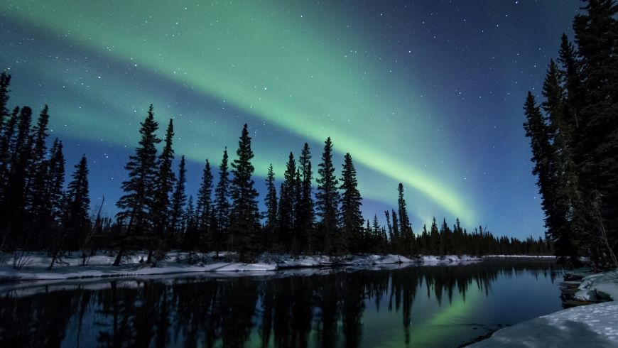 blue and green northern lights in lapland