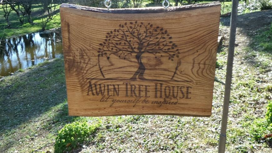awen treehouse logo on wooden piece